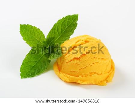 Scoop of yellow ice cream   - stock photo