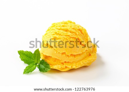 Scoop of yellow ice cream isolated on white