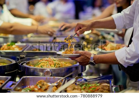 scooping the food. Buffet food at restaurant. Catering food  Stock photo ©