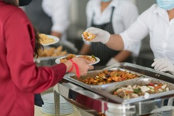 scooping the food, catering, dinner time