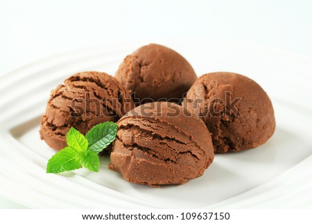 Scoops of chocolate ice cream on plate