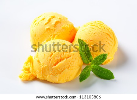 Scoops of yellow ice cream with mint