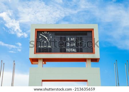 score board at football stadium on blue sky