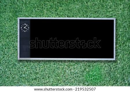 score board on green grass background