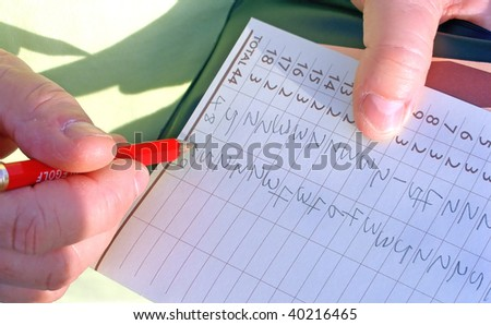 Score Card for Adventure Golf, adding up. - stock photo