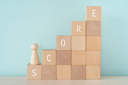 SCORE; Wooden blocks with