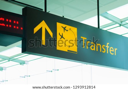 Scoreboard of the airport terminal transport transfer yellow with a picture of the aircraft and plane and arrows and information #1293912814