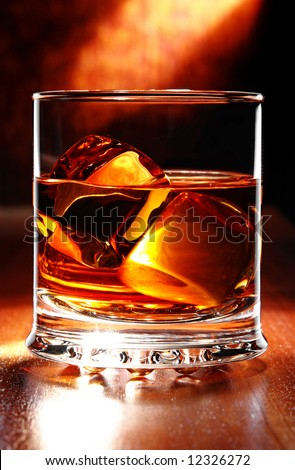 scotch whisky on a table with light behind