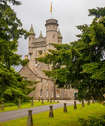 scotland castle in park with trees in foreground
