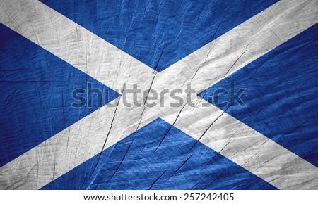 Scotland flag or Scottish banner on wooden texture