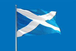 Scotland national flag waving in the wind on a deep blue sky. High quality fabric. International relations concept.