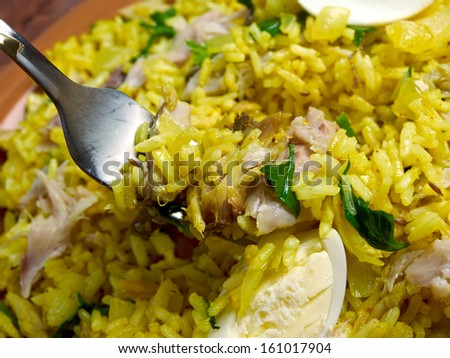 Scottish dish - Kedgeree, flakes of smoked herring baked with rice, milk,  parsley, and served with hard-boiled eggs.
