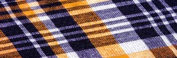 Scottish fabric culottes, blue and white, yellow, texture background, pattern