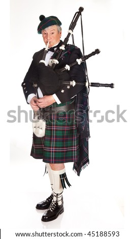 Scottish highlander wearing kilt and playing bagpipes Сток-фото ©