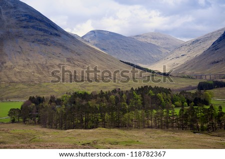 Scottish Highlands near the village of Glenfinnan with the famous Glenfinnan viaduct in the background