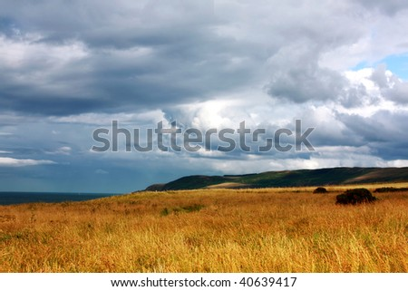 Scottish landscape with dramatic sky and fields