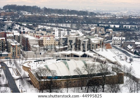 Scottish Parliament Building, Holyrood, Edinburgh,Scotland,UK, with Dynamic Earth centre in foreground, and Regent Terrace, and Fife just visible over the Firth of Forth in the background, in the snow