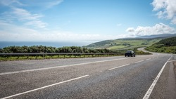 Scottish road trip. A view south along the arterial A9 road north of Helmsdale in the north east of Scotland. The road is one of the most northerly A roads on the British mainland.
