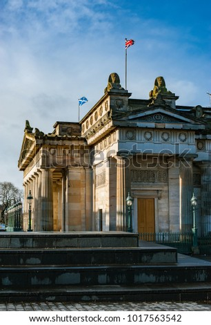 Scottish Saltire and British Union Jack flags on a top of Scottish National Gallery in Edinburgh Scotland