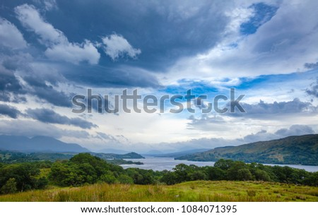 Scottish summer landscape with moody sky over Loch Awe, the longest freshwater loch in Scottish Highlands, Argyll and Bute, Scotland, UK #1084071395