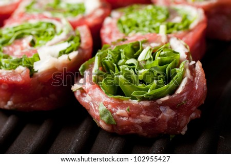 scottona veal rolls with cheese and rocket