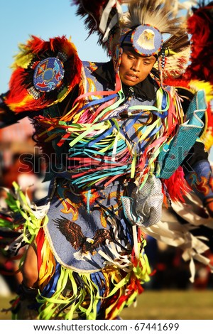 SCOTTSDALE, AZ - NOVEMBER 7: Dancers participate in the 24th Annual Red Mountain Eagle Pow-wow presented by the Salt River Pima-Maricopa Indian Community on November 7, 2010 in Scottsdale, Arizona.