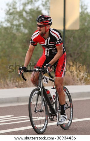 SCOTTSDALE, AZ - OCTOBER 4:A cyclist enjoys the competition of the 6th annual Tour de Scottsdale, a charity bicycle race benefiting the McDowell Sonoran Conservancy, on Saturday October 4, 2009