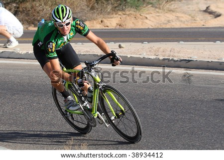 SCOTTSDALE, AZ - OCTOBER 4:A racer makes the turn after a 10 mile downhill in the 6th annual Tour de Scottsdale, a charity bicycle race on Saturday October 4, 2009 in Scottsdale Arizona