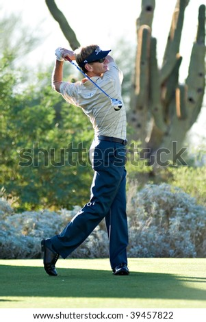 SCOTTSDALE, AZ - OCTOBER 22: Brad Faxon hits a drive in the Frys.com Open PGA golf tournament on October 22, 2009 in Scottsdale, Arizona. - stock photo