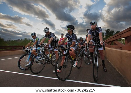 SCOTTSDALE, AZ - OCTOBER 4: Category 1 and 2 competitive cyclists prepare for the start of the 6th annual Tour de Scottsdale, a 70-mile charity bicycle race benefiting the McDowell Sonoran Conservancy in Scottsdale, AZ. - stock photo