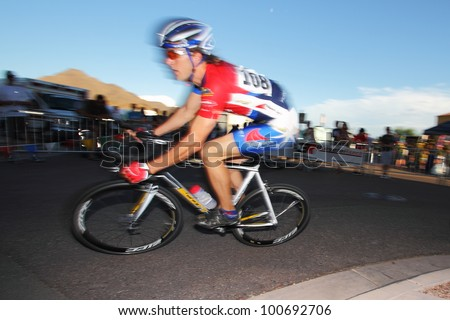 SCOTTSDALE, AZ - OCTOBER 2: Cyclists compete in the Scottsdale Cycling Festival Criterium, a high-speed circuit race on a 1-kilometer course for skilled cyclists in Scottsdale, AZ on October 2, 2010.