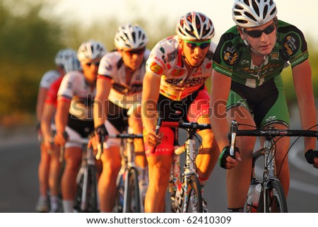 SCOTTSDALE, AZ - OCTOBER 2: Cyclists compete in the Scottsdale Cycling Festival Criterium, a high-speed circuit race on a 1-kilometer closed course on October 2, 2010 in Scottsdale, AZ.