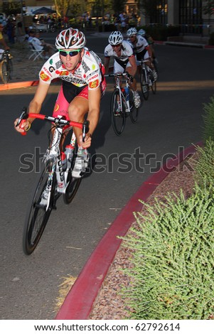 SCOTTSDALE, AZ - OCTOBER 2: Cyclists compete in the Scottsdale Cycling Festival Criterium, a high-speed circuit race on a 1-kilometer closed course on October 2, 2010 in Scottsdale, AZ. - stock photo