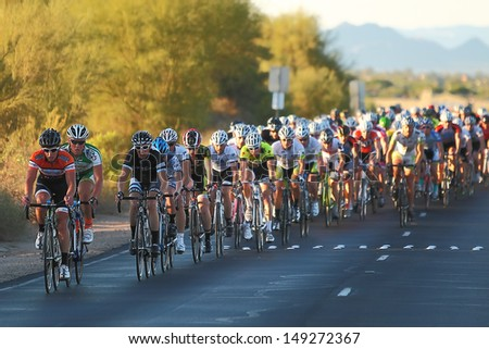 SCOTTSDALE, AZ - OCTOBER 14: Cyclists compete in the 9th annual Tour de Scottsdale, a 70-mile charity bicycle race benefiting the McDowell Sonoran Conservancy in Scottsdale, AZ on October 14, 2012.