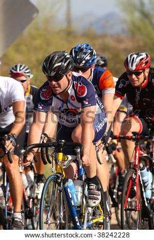 SCOTTSDALE, AZ - OCTOBER 4: Cyclists enjoy the competition of the 6th annual Tour de Scottsdale, a 70-mile charity bicycle race benefiting the McDowell Sonoran Conservancy on Saturday October 4, 2009 in Scottsdale, AZ.