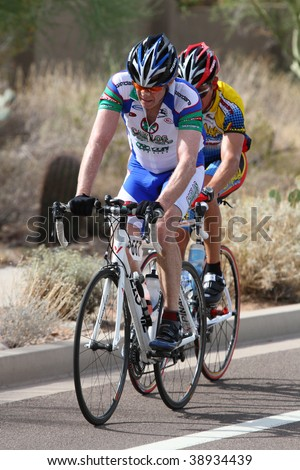 SCOTTSDALE, AZ - OCTOBER 4:Cyclists enjoy the competition of the 6th annual Tour de Scottsdale, a 70-mile charity bicycle race benefiting the McDowell Sonoran Conservancy?on Saturday October 4, 2009