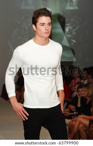 SCOTTSDALE, AZ - OCTOBER 7: Models showcasing designs from the Evan Golf collection at the Phoenix Fashion Week runway shows on October 7, 2010 in Scottsdale, AZ.