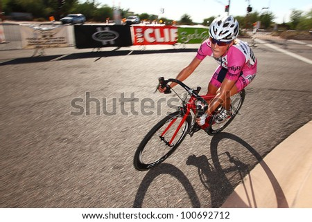 SCOTTSDALE, AZ - OCTOBER 2: Women cyclists compete in the Scottsdale Cycling Festival Criterium, a high-speed circuit race on a 1-kilometer closed course in Scottsdale, AZ on October 2, 2010.