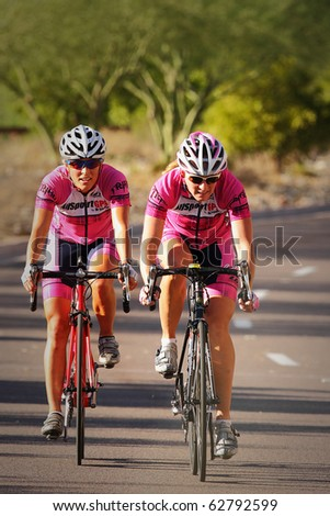 SCOTTSDALE, AZ - OCTOBER 2: Women cyclists compete in the Scottsdale Cycling Festival Criterium, a high-speed circuit race on a 1-kilometer closed course on October 2, 2010 in Scottsdale, AZ.