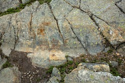 Scoured granite bedrock, with glacial striations and a large groove, on the bald summit of Mt. Kearsarge in Wilmot, New Hampshire.