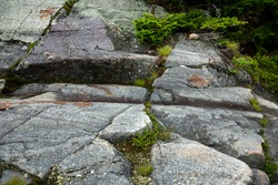 Scoured granite bedrock, with glacial striations and grooves, at the bald summit of Mt. Kearsarge in Wilmot, New Hampshire.