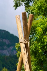 Scout Construction with Poles and Ropes / Detail of a Scout construction with three wooden poles and ropes
