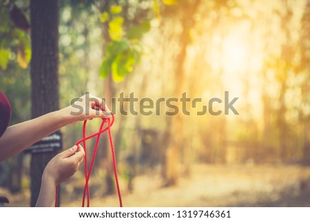 Scout learning concept, scout knot learning in forest in camping of boy scout on hills. Education teacher teaching tie knot for children in boy camp on hills Stock photo ©