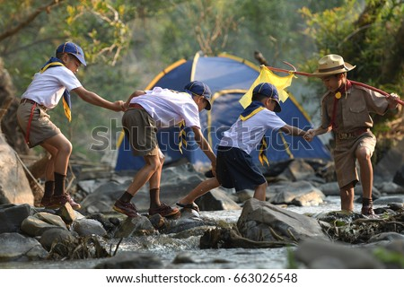 Scouts are helping to cross the river. Stock photo ©