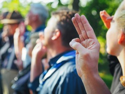 Scouts Honor hand gesture close up