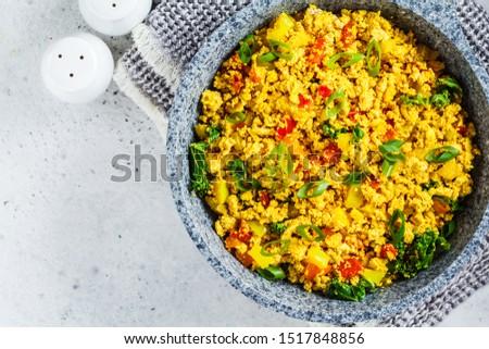 Scramble tofu with vegetables in a pan. Vegan Alternative Omelet. Сток-фото ©