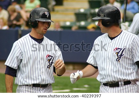 SCRANTON - JUNE 26: Scranton Wilkes Barre Yankees Brett Gardner goes to shake hands after scoring in a game against the Columbus Clippers at PNC Field June 26, 2008 in Scranton, PA.