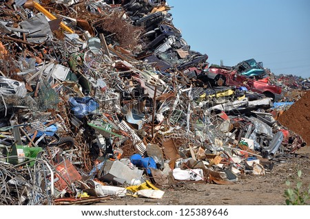 Scrap heap - Scrap Metal ready for recycling with blue sky