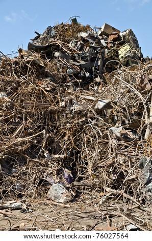 Scrap metal piled in port docks for export.