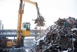 Scrap metal recycling plant and crane-loading scrap in a train